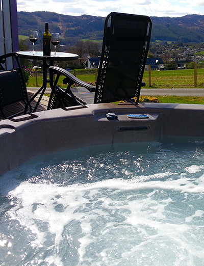 A private hot tub on the patio deck outside your log cabin Scotland.  All Spa Lodge, Premium Spa Lodge, Love Cabin and Premium Love Cabin Log Cabins feature a private hot tub on the patio deck.