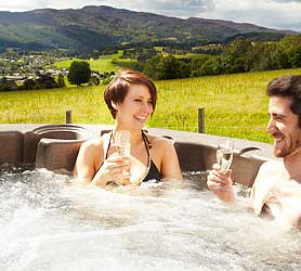 Premium lodges with hot tubs scotland for two with extra space and king sized bed